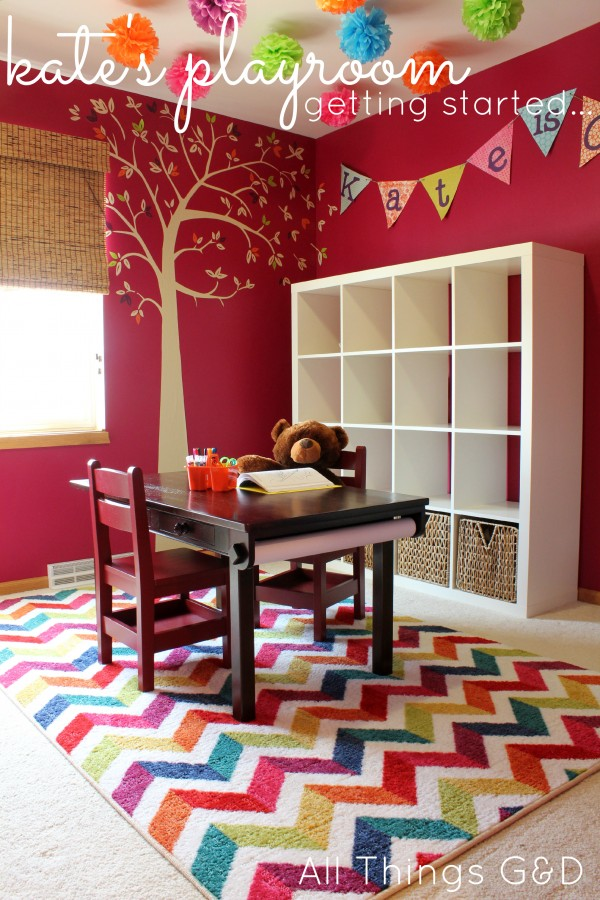 playroom, magenta paint color, IKEA Expedit, wall decal, tree wall decal, tissue poms, ceiling tissue poms