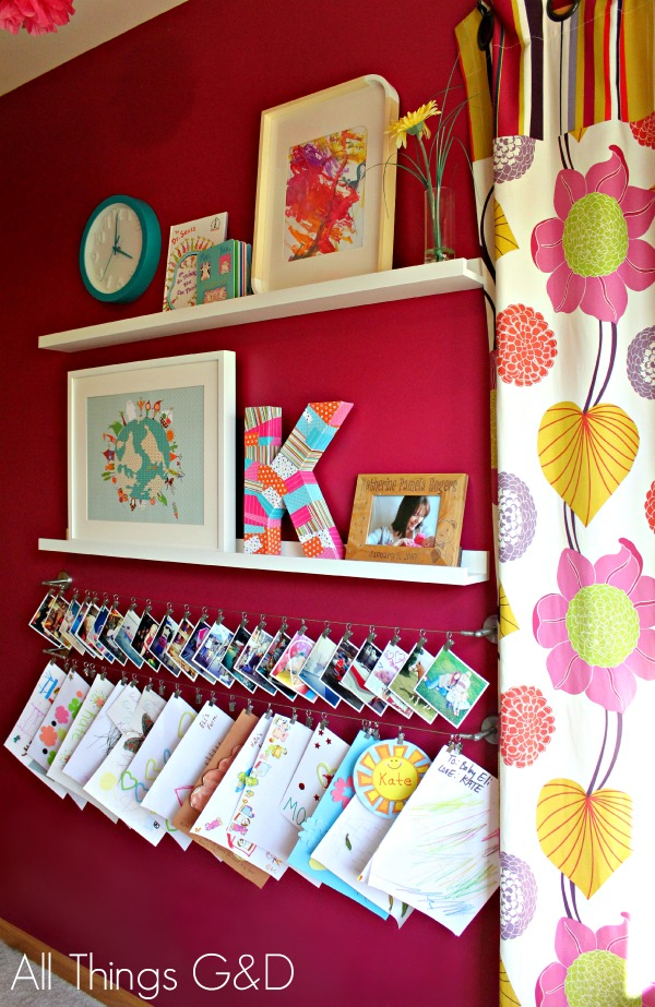 Personalized art & photo display wall in Kate's playroom. | www.allthingsgd.com