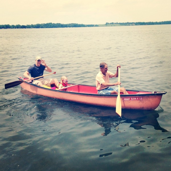 Kate (3 years, 5 months) canoeing with Daddy and Grandpa on Rock Lake.