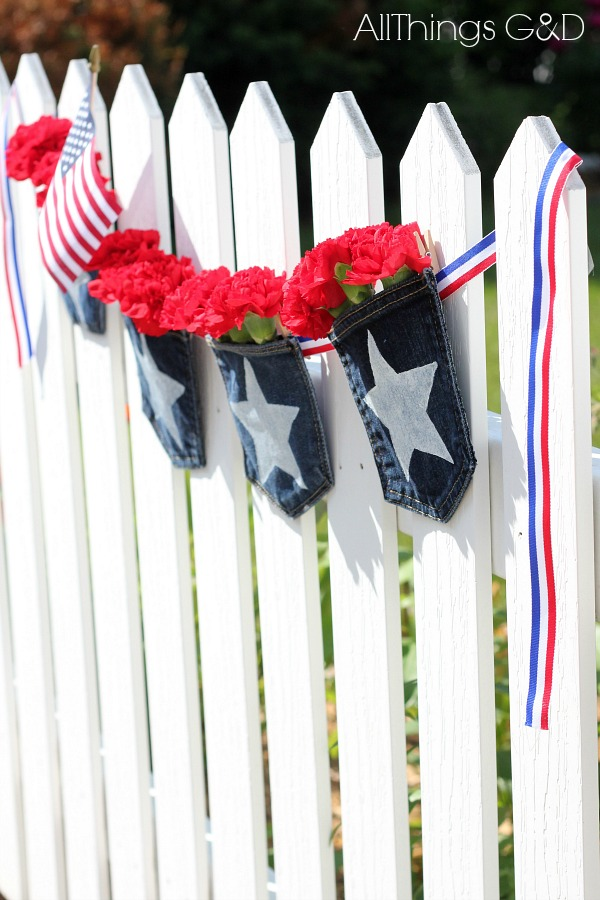 Painted Denim Pocket Bunting - fill the pockets with flowers and flags for a decorative look, or make them functional for your backyard BBQ and fill them with sunscreen and bug spray, or silverware and condiments! | www.allthingsgd.com