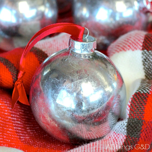 Recreate the look of mercury glass ornaments for less with this Faux Mercury Glass Ornaments DIY tutorial! | www.allthingsgd.com