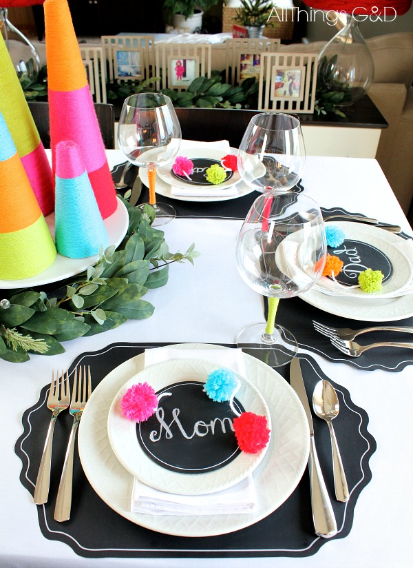 Bring color and whimsy to your holiday table with this colorful Christmas tablescape decorated with chalkboards and yarn! | www.allthingsgd.com