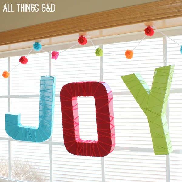 Create a festive garland for your holiday decor, birthday party or baby shower with this DIY Pom Pom Garland tutorial, complete with step by step pictures. | www.allthingsgd.com