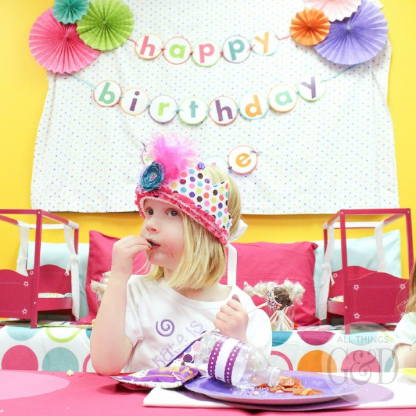 A fun, colorful, and playful polka dot pajama birthday party, including tables dressed to look like beds, personalized pillowcase party favors, doll beds as cookie platters, and a polka dot cake! | www.allthingsgd.com