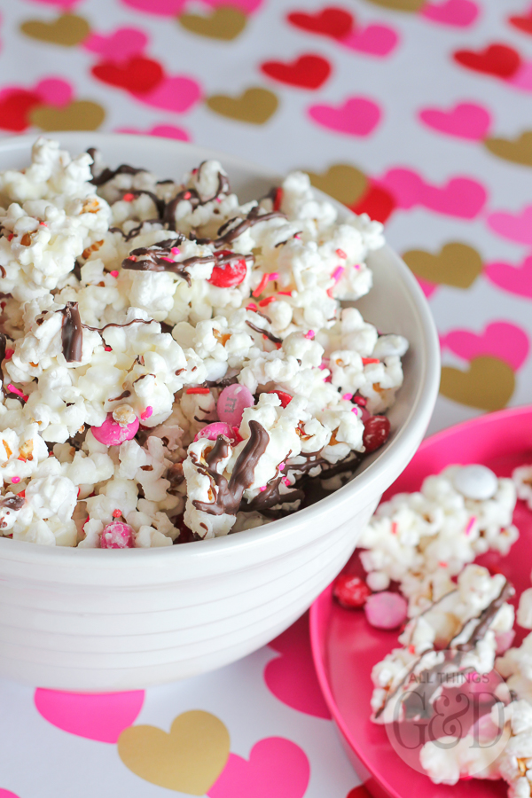 Got a sweet tooth that just won't quit?  Treat it with this Super Sweet Valentine's Popcorn Mix this Valentine's Day!  (Makes a great treat for school Valentine exchanges!) | www.allthingsgd.com
