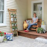 Lowe's Front Yard Makeover in Portland, Maine featuring a new paver patio, outdoor decorations, Pella carriage style garage door, and trim-free landscape edging.