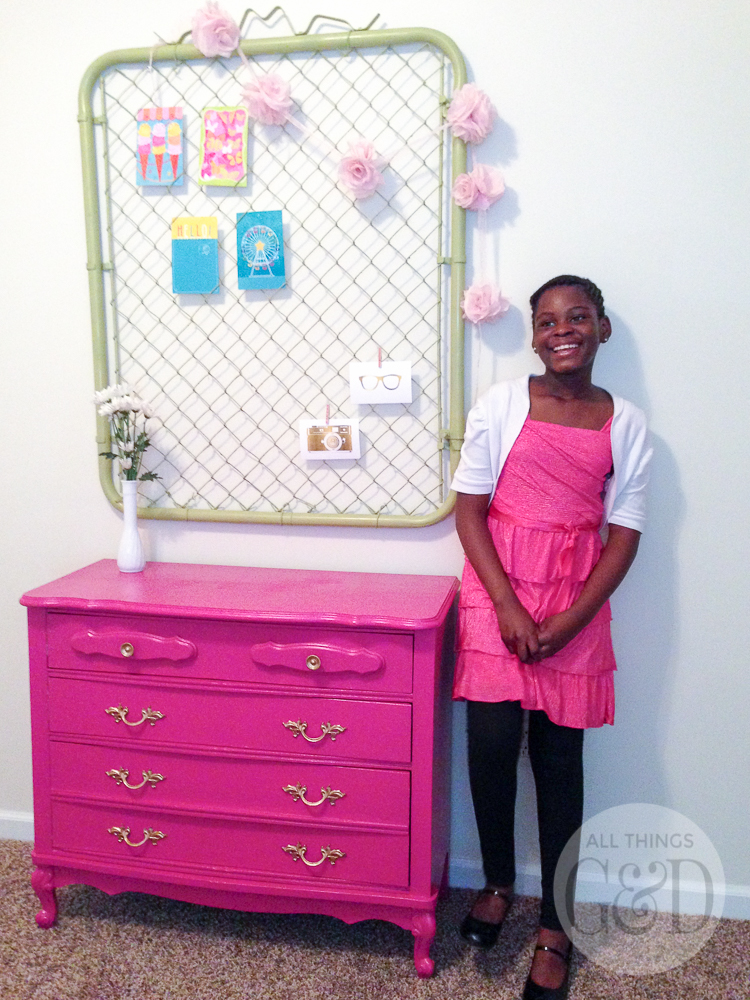 A colorful and playful girl's room created by Dusty Rogers of All Things G&D as part of GMC's 2015 Hidden Treasure Adventure. With a budget of just $285, she furnished and decorated the room with items found along the World's Longest Yard Sale. This $30 dress gets a new life with fresh paint, and a chain link fence gate (found for $25) spray painted a fresh lime green makes a fun and unique all organizer. #GMCHTA #HabitatforHumanity