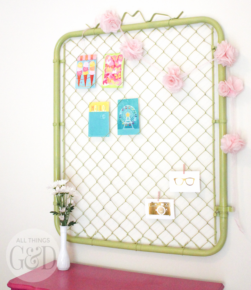 A colorful and playful girl's room created by Dusty Rogers of All Things G&D as part of GMC's 2015 Hidden Treasure Adventure. With a budget of just $285, she furnished and decorated the room with items found along the World's Longest Yard Sale. This chain link fence gate (found for $25) spray painted a fresh lime green makes a fun and unique all organizer. #GMCHTA #HabitatforHumanity