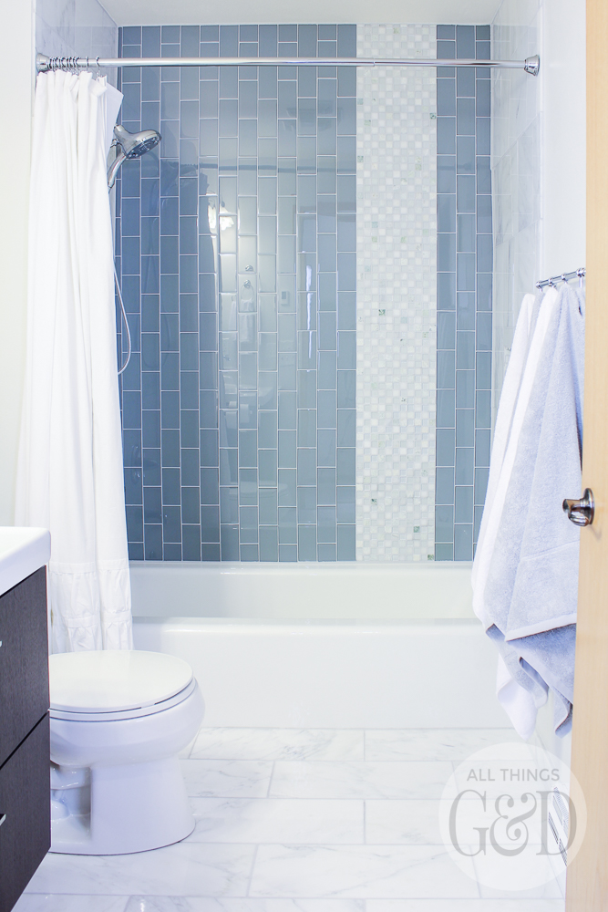 Marble and glass tile bathroom makeover featuring tile from The Tile Shop and kid-friendly fixtures from Delta Faucet. #thetileshop #deltafaucet #DeltaLiving