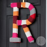 Repurpose an old cable knit sweater to make a DIY Sweater Monogram Wreath. | All Things G&D